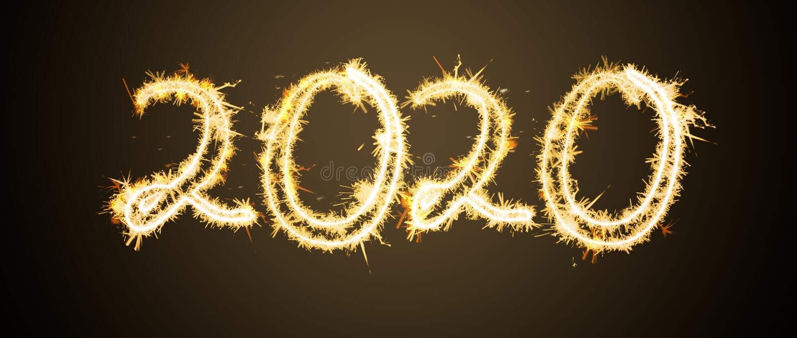 Inscription 2020 from Bengal lights. New Year`s and Christmas concept stock images