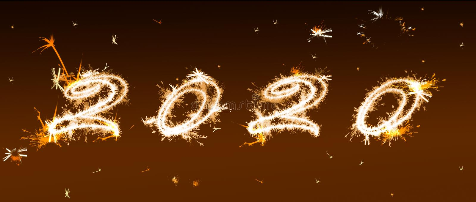 Inscription 2020 from Bengal lights. New Year`s and Christmas concept. On a black background Banner stock images