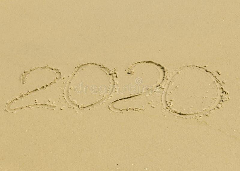 The inscription on the sand 2020 stock photo