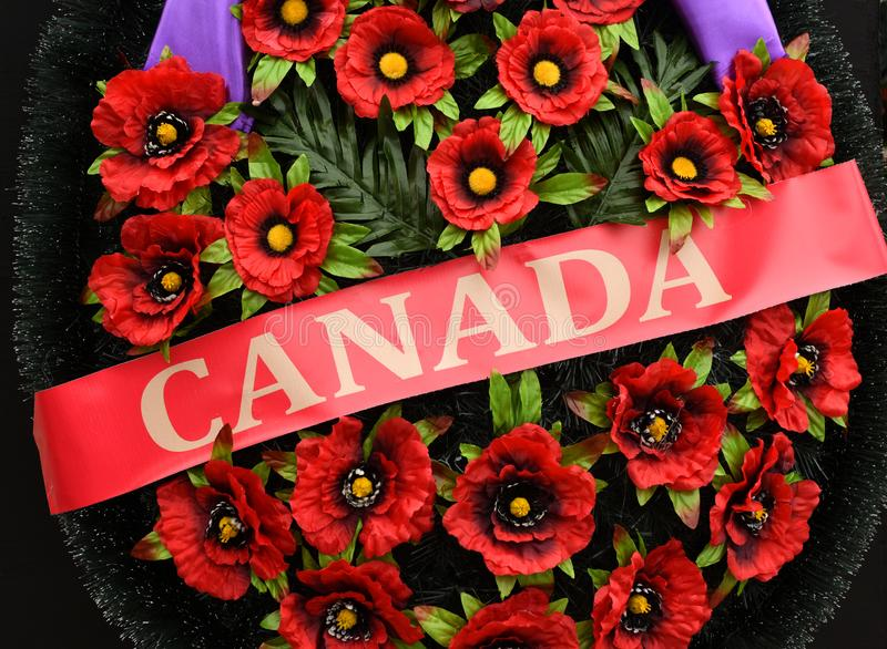 Inscription Canada on the wreath of poppies. Remembrance Day. Poppy day.  stock photos