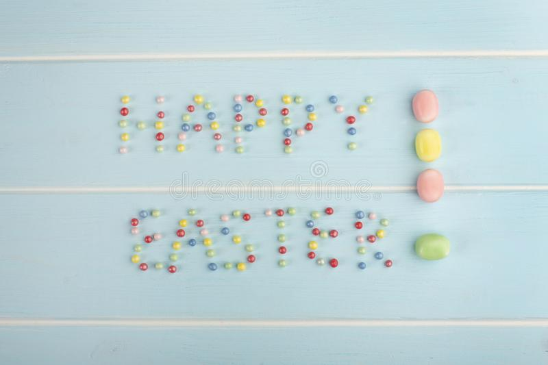 The words Happy Easter with colorful confectionery dressing stock photography