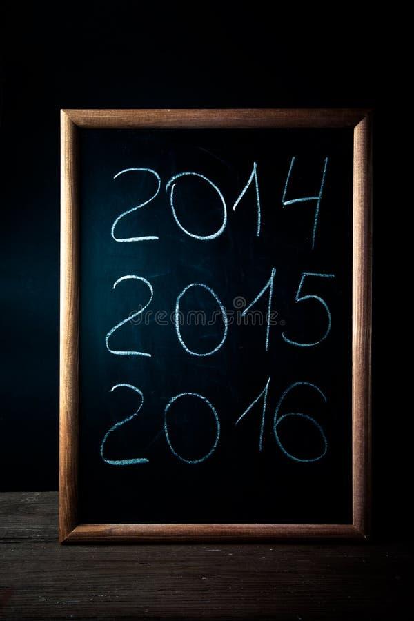 Inscription 2014 craie 2015 2016 sur un tableau noir photo stock image du ensuite classroom for Ecrire sur un tableau noir