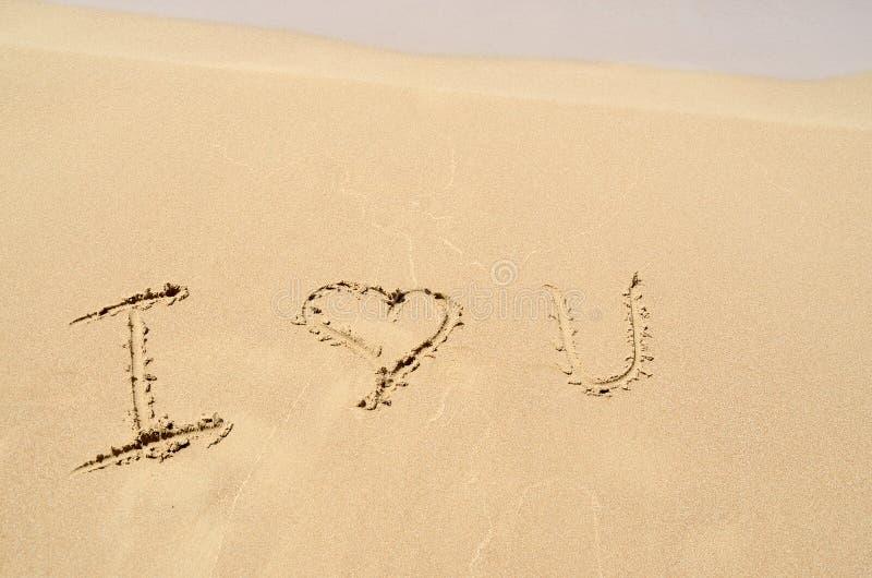 Inscription dans le sable photo libre de droits