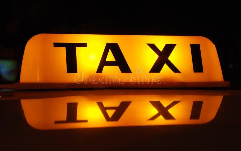 Inscription de TAXI photographie stock libre de droits