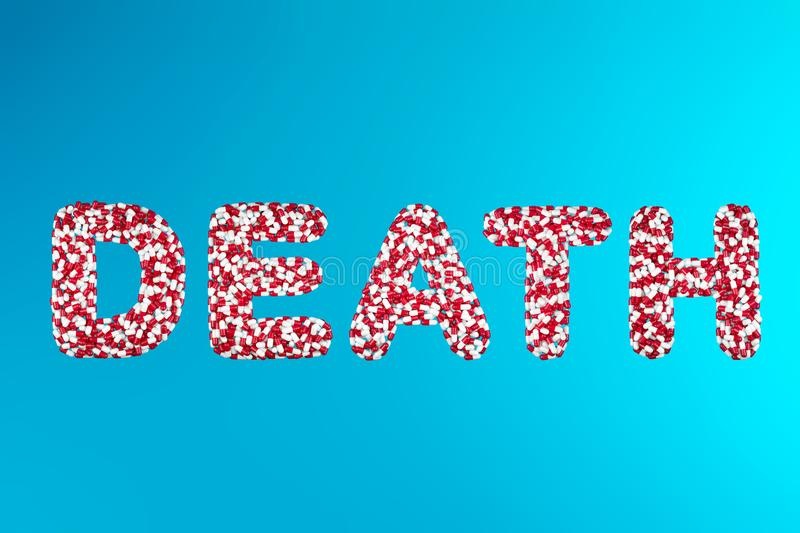 Inscription death white and red pills on a blue background stock image