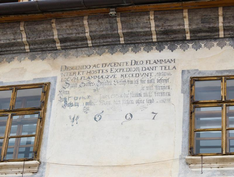 The inscription on a decorative decorated wall dated 1697 in the castle of old city. Sighisoara city in Romania stock photography