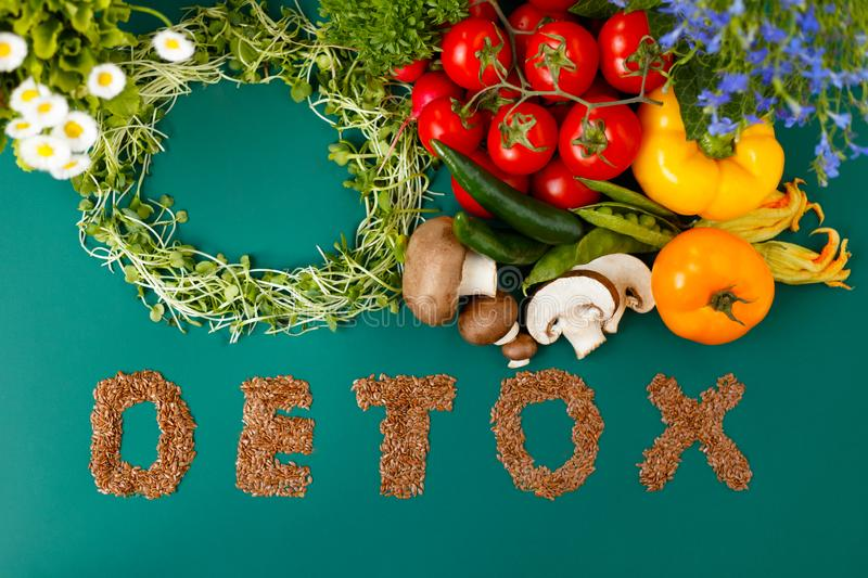 Inscription detox from laxseed combinatio vegetables, on a green background. Various vegetables, micro plants royalty free stock photo
