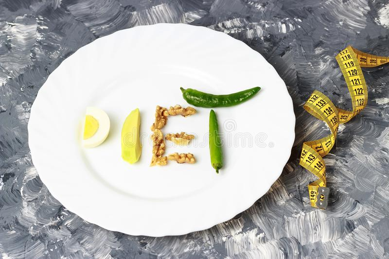 Inscription Diet made of nuts, eggs and avocado. weight loss concept royalty free stock image