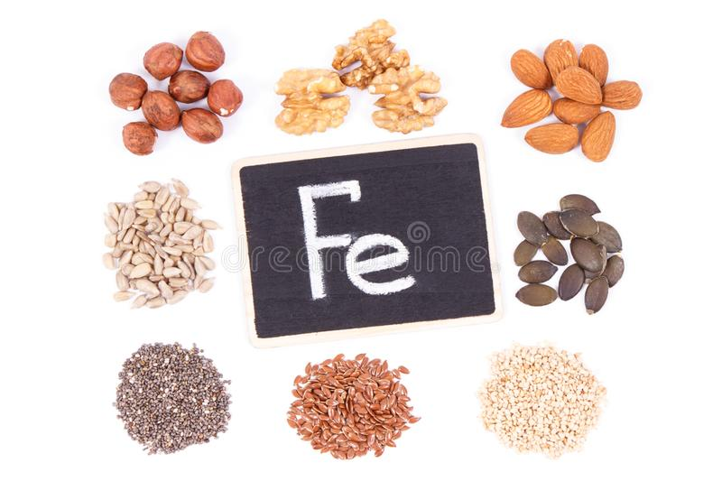 Inscription Fe and ingredients as source iron, omega acids, vitamins, minerals and fiber. Inscription Fe and natural healthy ingredients or products as source royalty free stock photos