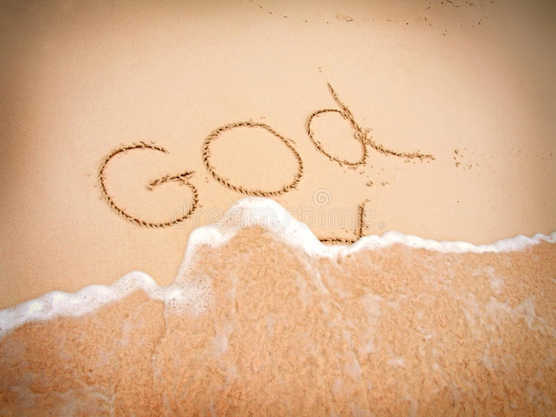 The inscription God. The inscription on the sand - God royalty free stock image