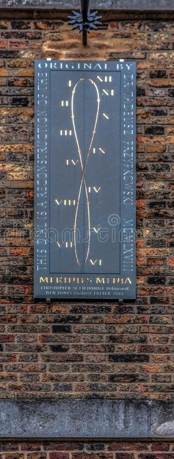 Inscription with Greenwich noon dial on the Royal Observatory wa. LONDON, ENGLAND - NOVEMBER 29, 2017:Inscription with Greenwich noon dial on the Royal royalty free stock image