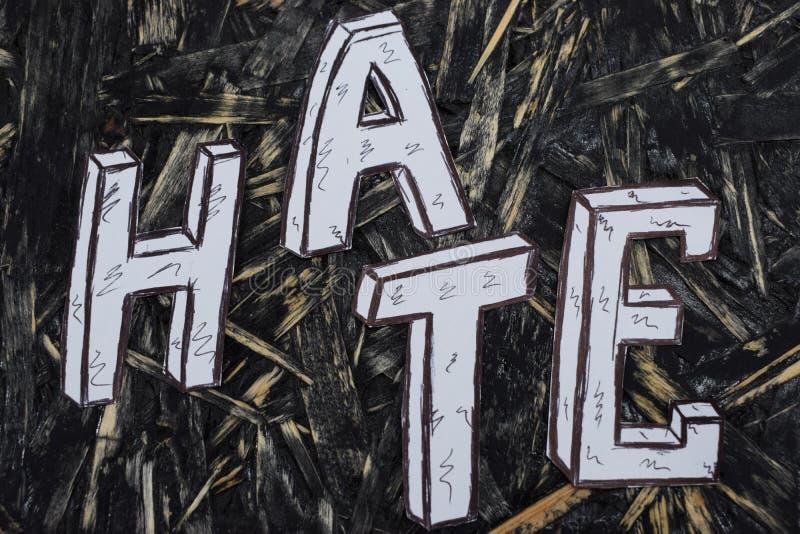 Inscription, haine, sur le fond de hernom avec les lettres blanches photographie stock