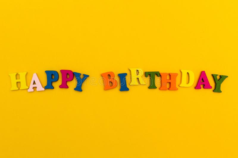 The inscription `Happy Birthday` in colorful letters on a yellow background royalty free stock image