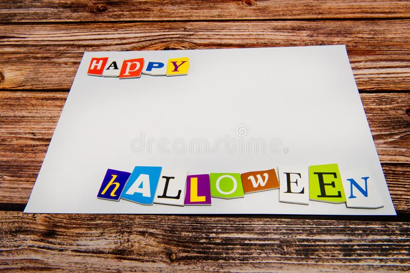 Inscription `Happy Halloween` with empty copy space on wooden table. Halloween Background royalty free stock images