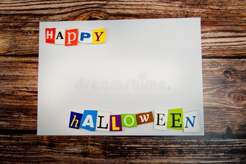 Inscription `Happy Halloween`. Halloween Background with empty copy space on wooden table royalty free stock image