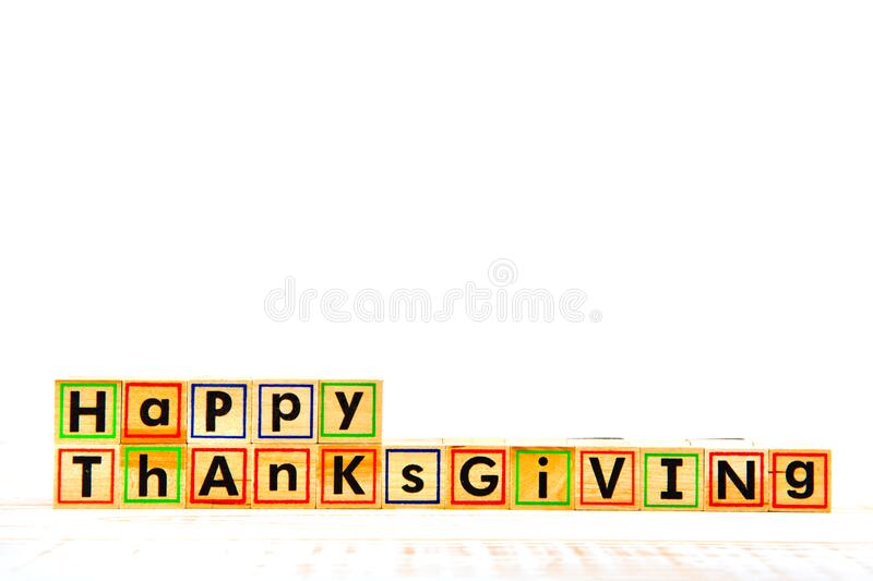 Inscription `Happy Thanksgiving` with empty copy space. Inscription `Happy Thanksgiving` with empty copy space on wooden white table stock photo