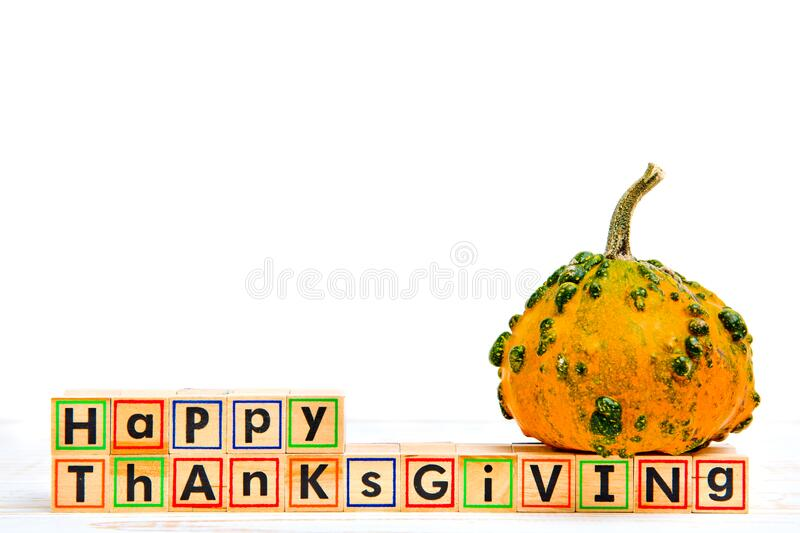 Inscription `Happy Thanksgiving` with empty copy space. Inscription `Happy Thanksgiving` with empty copy space on wooden white table with pumpkin royalty free stock images