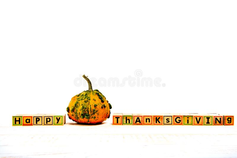 Inscription `Happy Thanksgiving` with empty copy space on wooden white table. Inscription `Happy Thanksgiving` with empty copy space on wooden white table with stock photo