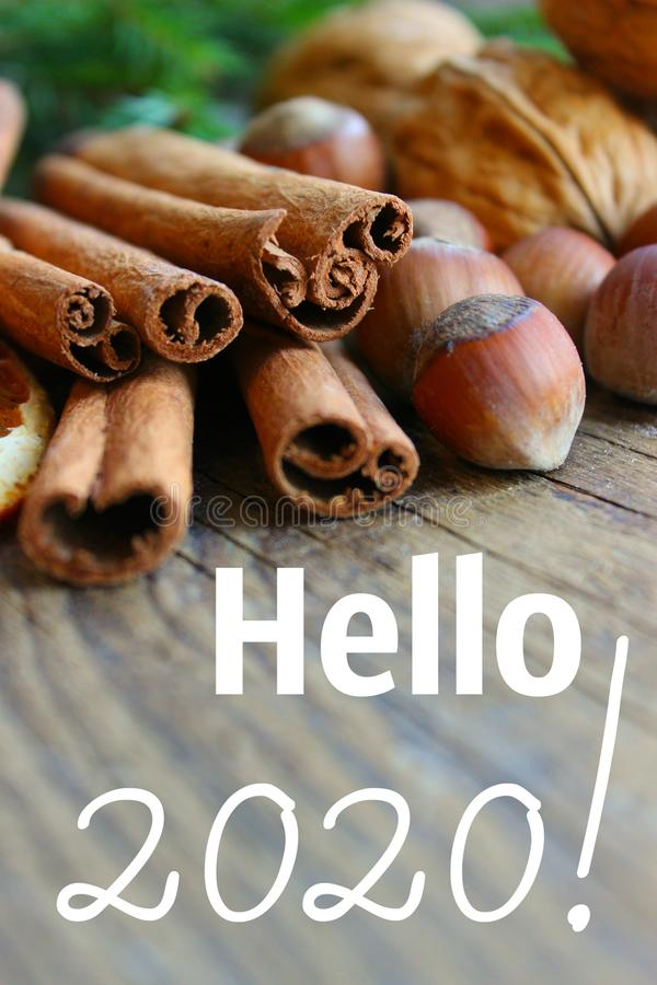 The inscription Hello 2020! Concept of the new year 2020. top border of festive spices and baking ingredients on rustic wooden bac. Kground. Christmas, New year stock images
