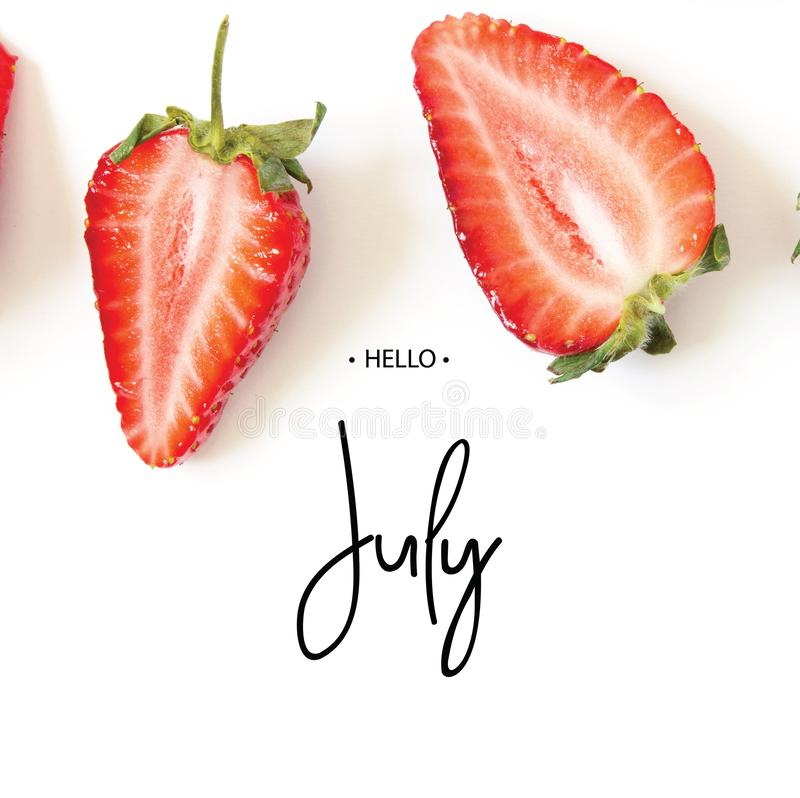 Inscription Hello July. Creative fresh strawberries pattern background. royalty free stock images