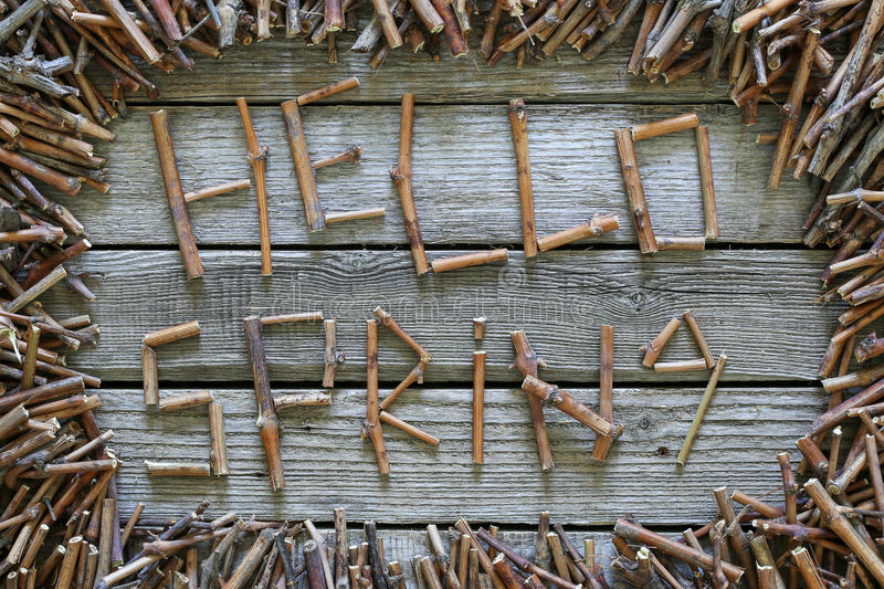 The inscription Hello spring with wooden sticks on wooden background. stock photos