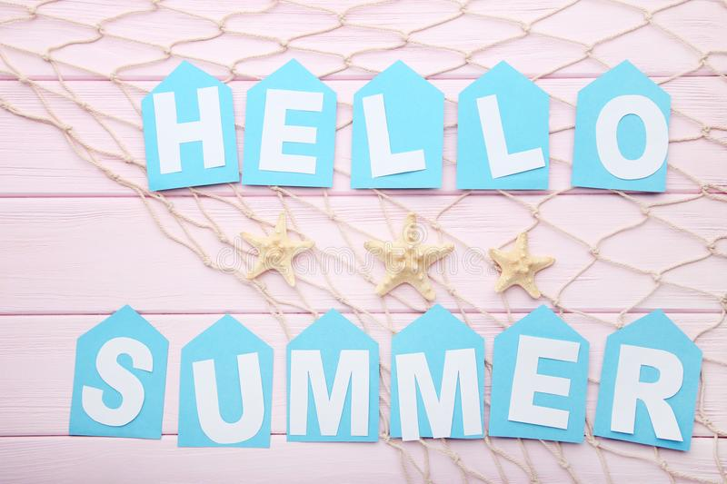 Inscription Hello Summer with starfishes royalty free stock images