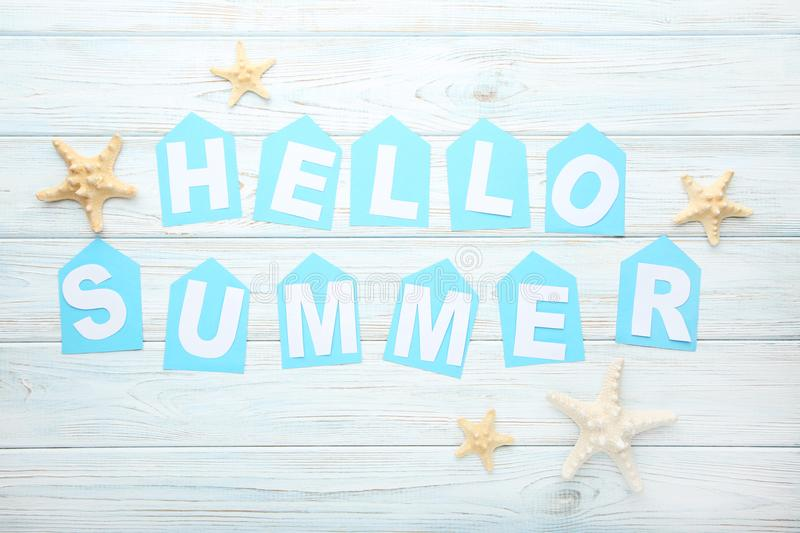 Inscription Hello Summer with starfishes stock photos