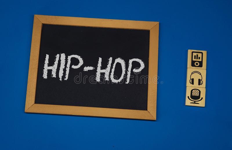 Inscription HIP HOP on a black board with a blue background with three wooden cubes. FOLKS word on square concept, hip, hop, art, background, genre, musical royalty free stock photos
