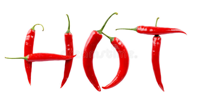Inscription Hot made from red chilli peppers isolated white royalty free stock images