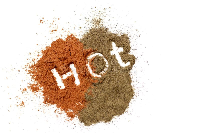 Inscription hot on a red ground paprika and black pepper, isolated on white background, top view.  stock photos