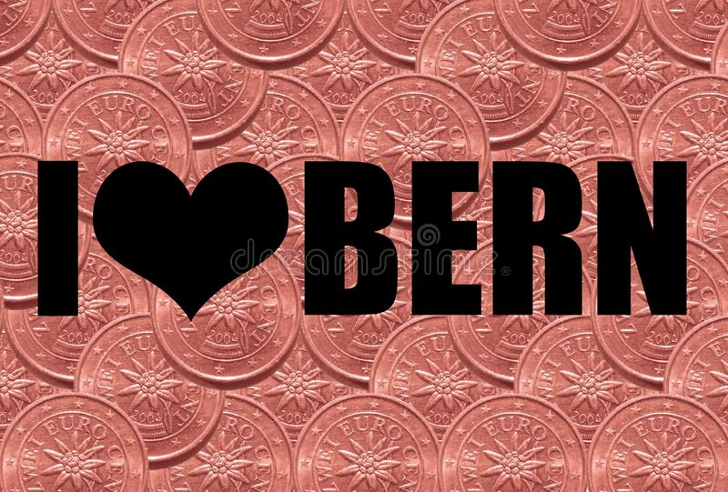 The inscription `I love Bern` in black font on a background of two euro cents. Concept stock photo