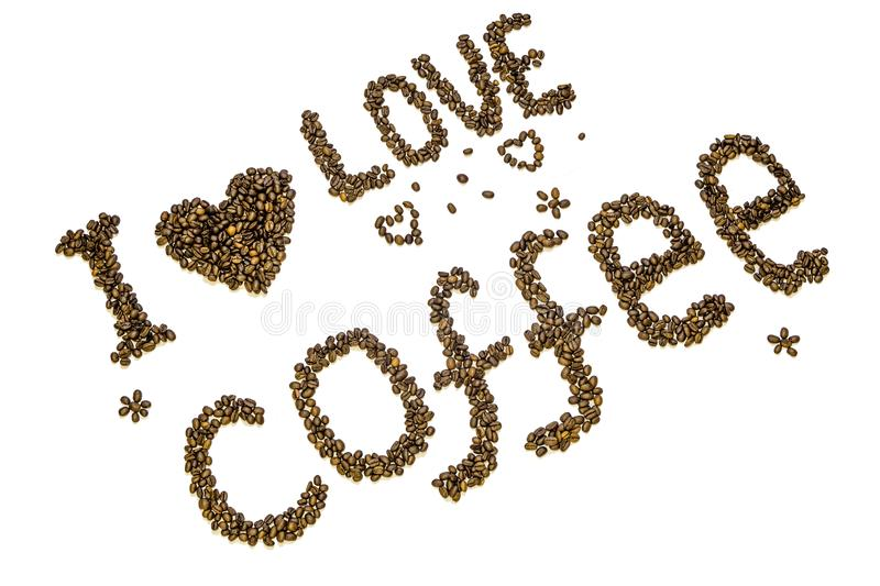 Inscription `I love coffee` with heart symbol made of roasted coffee beans stock image