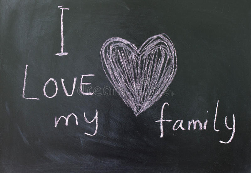 Inscription I love my family. The inscription on the blackboard with crayons I love my family royalty free stock photos