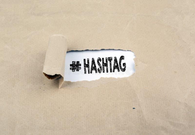 Inscription indiquée sur le vieux papier - Hashtag photographie stock libre de droits