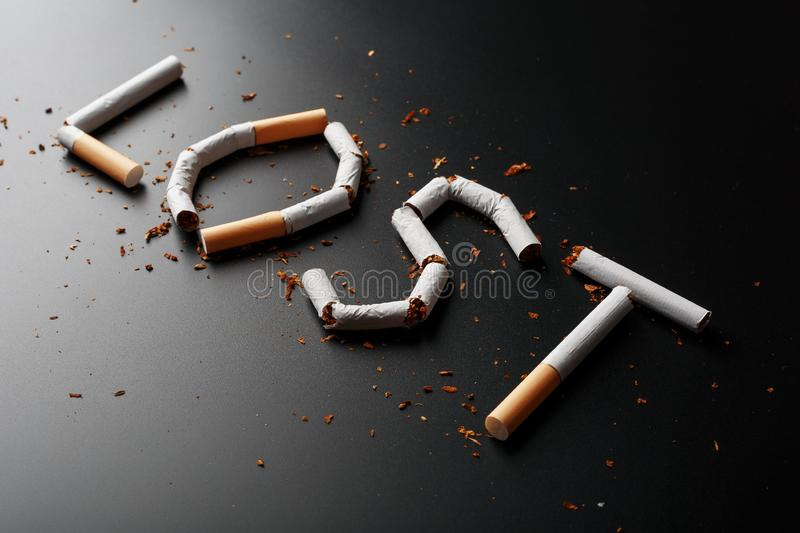 The inscription LOST from cigarettes on a black background. Stop smoking. The concept of smoking kills. Motivation inscription to. Quit smoking, unhealthy habit royalty free stock photos