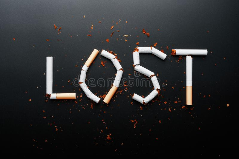 The inscription LOST from cigarettes on a black background. Stop smoking. The concept of smoking kills. Motivation inscription to. Quit smoking, unhealthy habit royalty free stock images