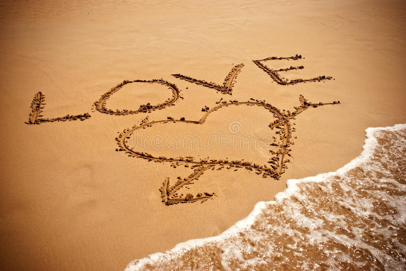 Inscription LOVE And Drawing A Heart Royalty Free Stock Image
