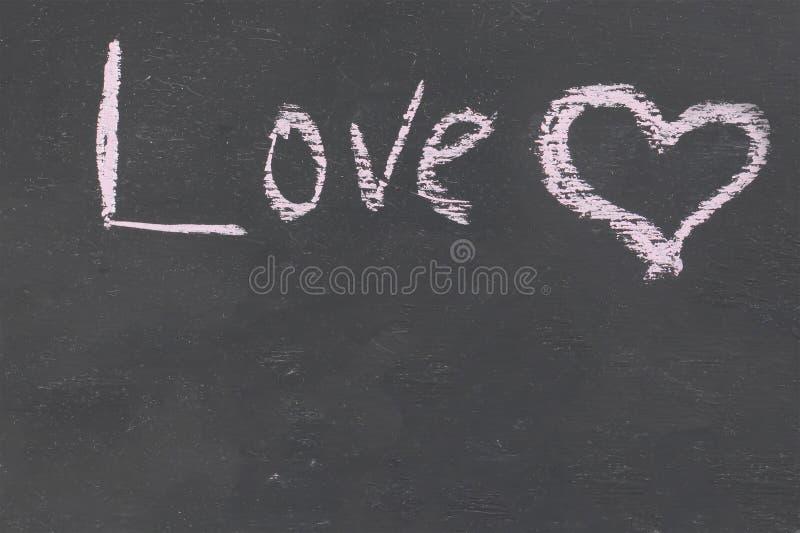 Inscription love heart chalk decoration decor romantic copy space on black slate background stock photo