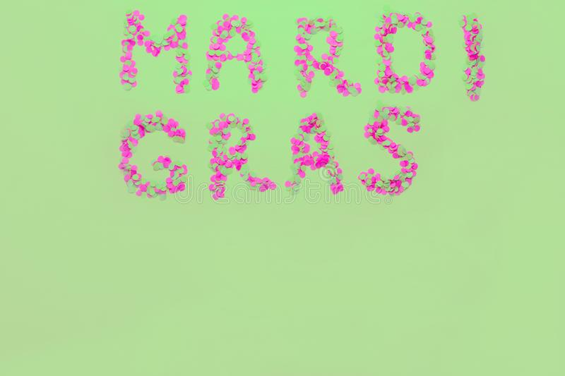 Inscription Mardi Gras from confetti. Mardi Gras. Holiday decoration cards, greetings, invitation card, banner. Inscription Mardi Gras from confetti. Mardi Gras stock image