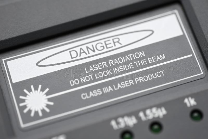 Inscription when measuring optical fiber danger laser radiation do not look inside the beam royalty free stock photos