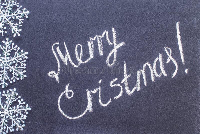 Inscription Merry Christmas on chalkboard. written on a blackboard royalty free stock photography