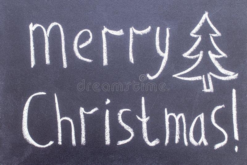 Inscription Merry Christmas on chalkboard stock photos