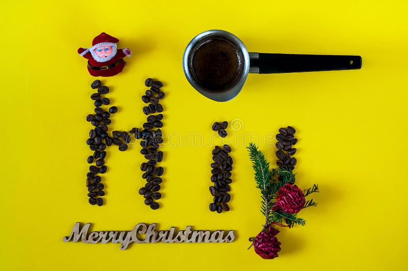 Inscription of merry Christmas and Hi, laid out from the beans of coffee.Creative background with coffee-color of the year 2019 royalty free stock photo