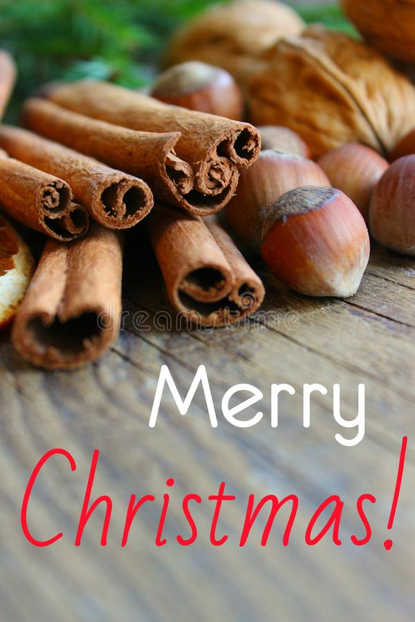 Inscription Merry Christmas.  top border of festive spices and baking ingredients on rustic wooden background. Christmas, New year background. Copy space stock photos