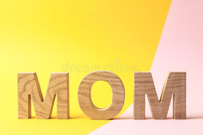 Inscription mom on two tone background. Space for text royalty free stock photos