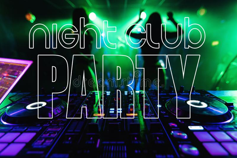 Inscription Night Club Party on the background of the DJ mixer and blurred silhouettes of go-go dancers royalty free stock photo