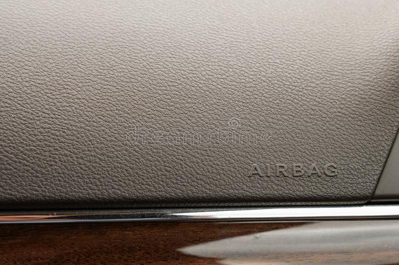Inscription on the panel of the vehicle airbag. background of grey textured plastic close-up royalty free stock photos
