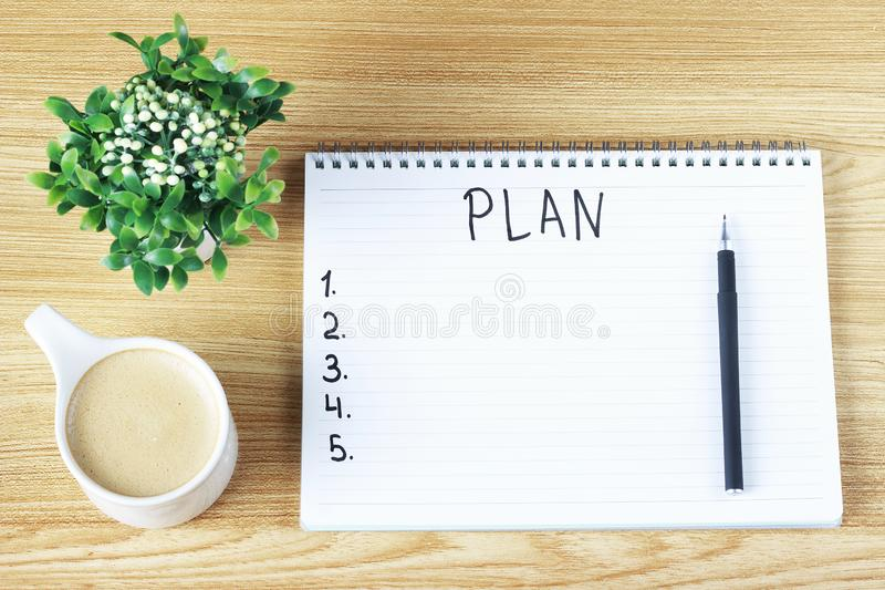 Inscription Plan in notepad, close-up, top view, concept of planning, goal setting stock photography