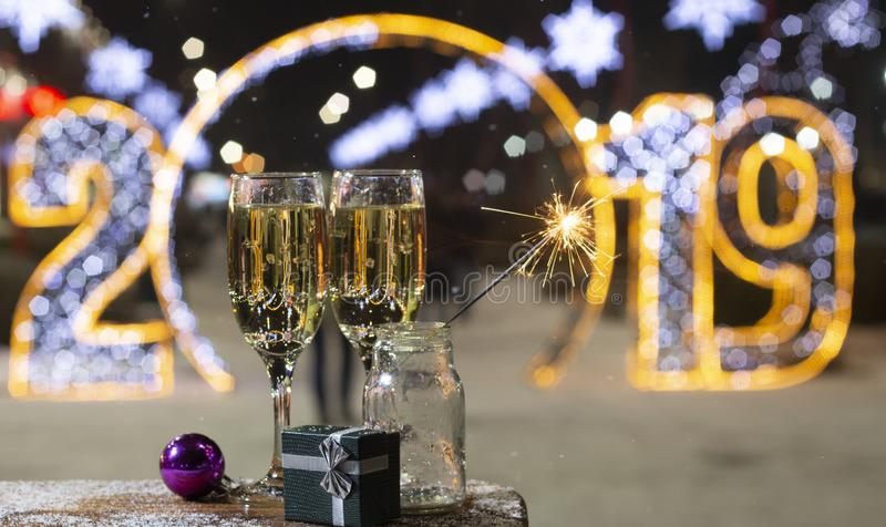 The inscription 2019 in Rasfokus, sparkler in the foreground, the concept of the new year. Background royalty free stock images