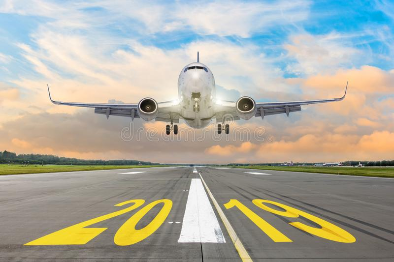 The inscription on the runway 2019, plane taking off. The concept of travel in the new year, holidays. The inscription on the runway 2019, plane taking off. The stock image